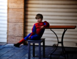 child in spiderman costume
