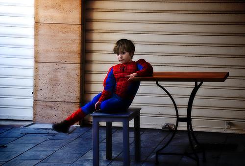 child in spiderman costume